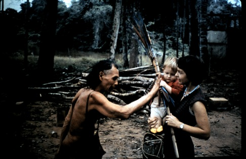 "James-Gill-in-the-arms-of-his-mother-Elsie-receives-a-""first-gift""-from-an-Araona-India-chief-in-Bolivia.-Courtesy-of-James-Gill"